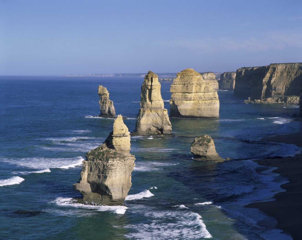 Eroded rocks in the ocean, Twelve Apostles, Port Campbell National Park, Victoria, Australia : Stock Photo