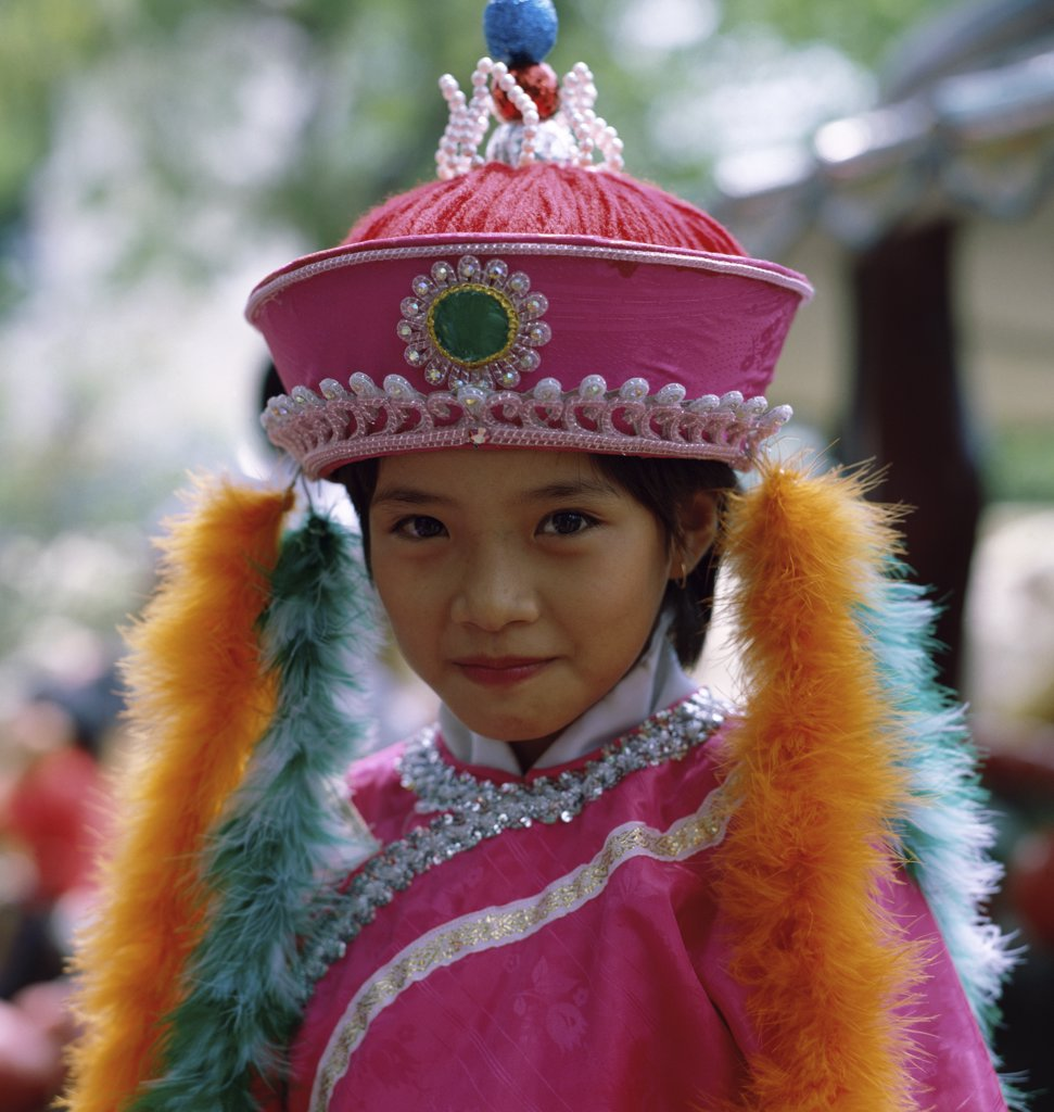 Portrait of a girl wearing traditional clothing, Singapore : Stock Photo