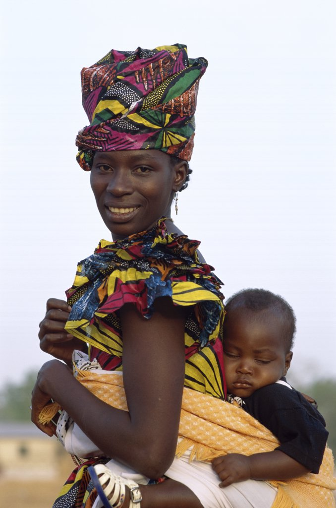 Stock Photo: 1288-456 Portrait of a mother carrying her child, Banjul, Gambia