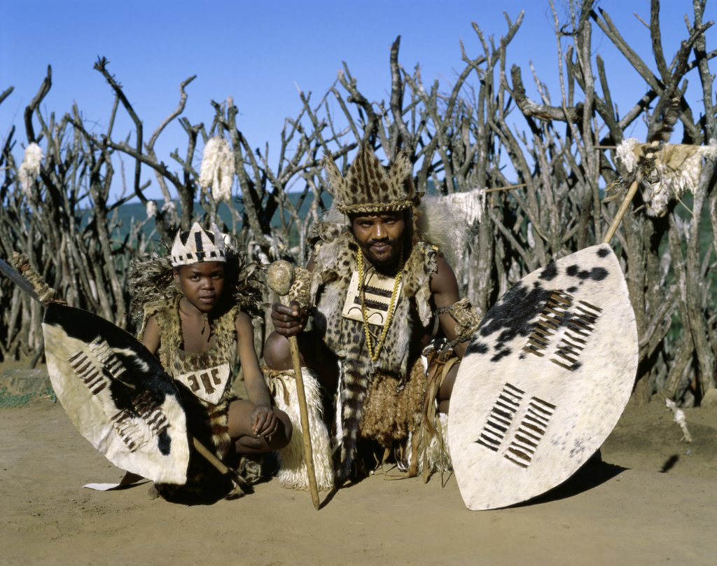 Father and son wearing traditional clothing, Zulus, Kwazulu-Natal, South Africa : Stock Photo