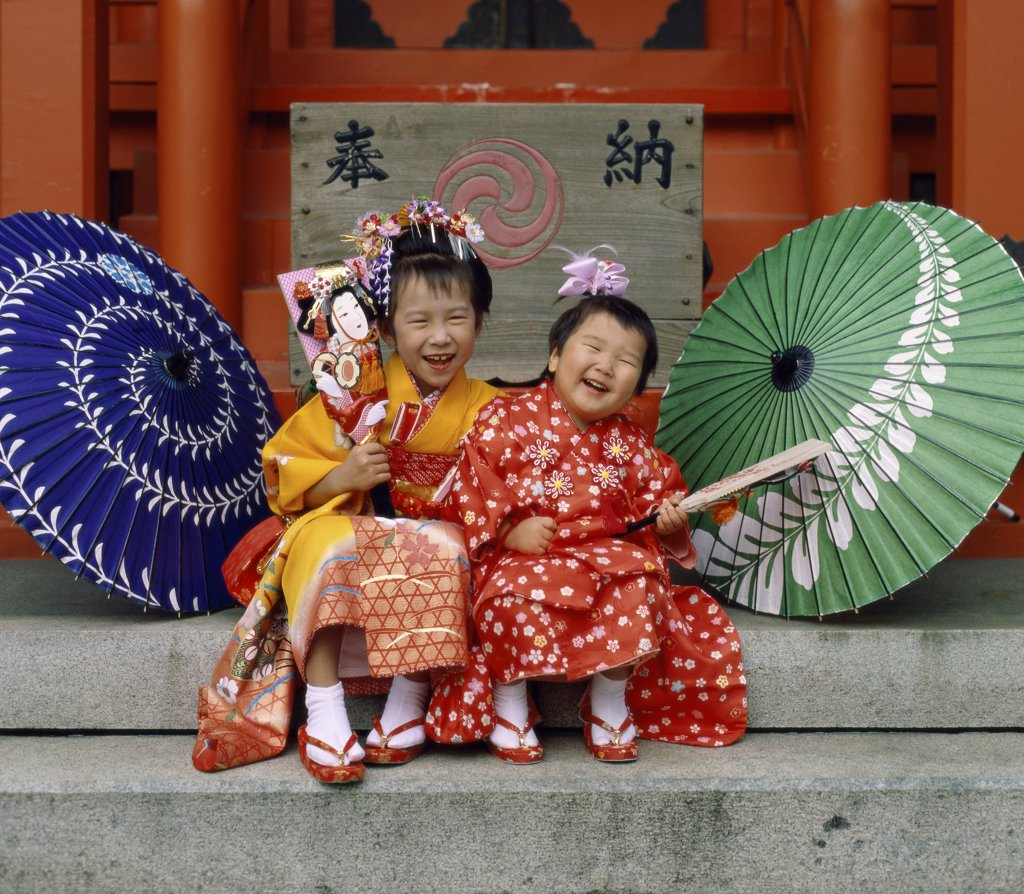 Portrait of two girls smiling, Japan : Stock Photo