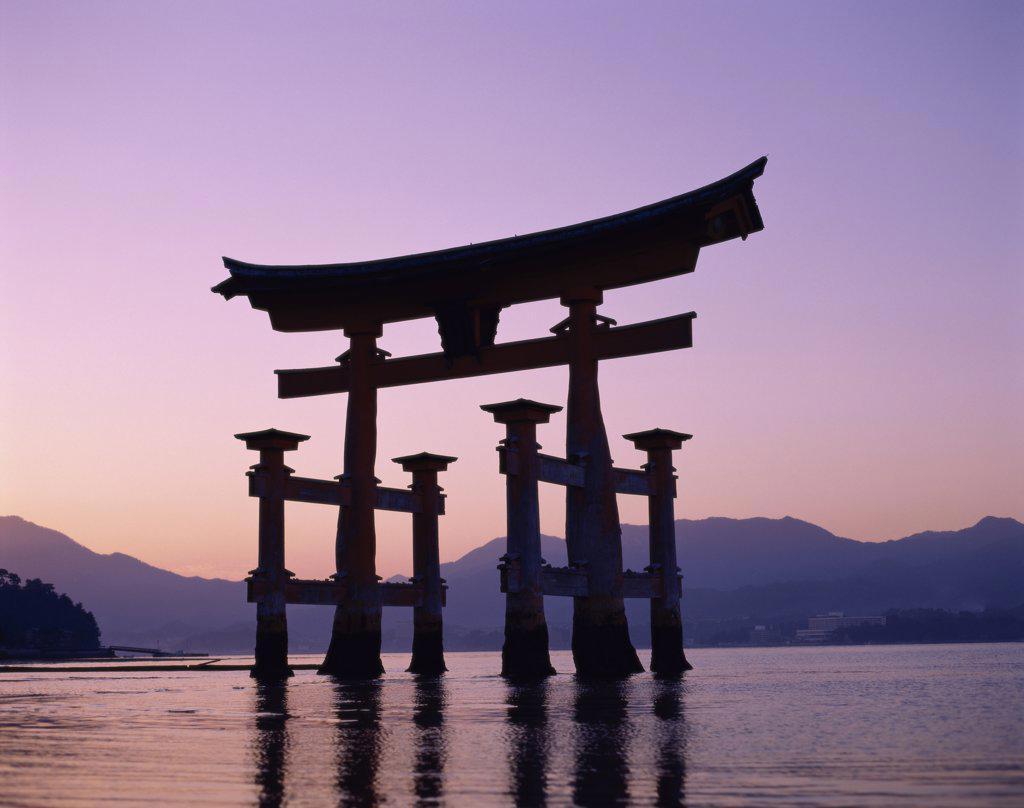 Stock Photo: 1288-683 Reflection of a gate in water, Torii Gate, Itsukushima Shrine, Miyajima, Japan