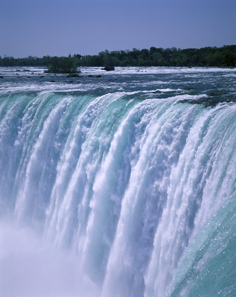 Stock Photo: 1288-702B Water flowing over Niagara Falls, Ontario, Canada