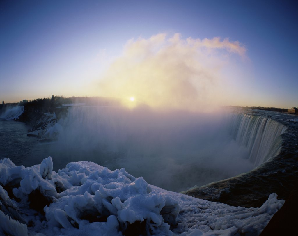 Stock Photo: 1288-716 Sunrise over a waterfall, Niagara Falls, Ontario, Canada