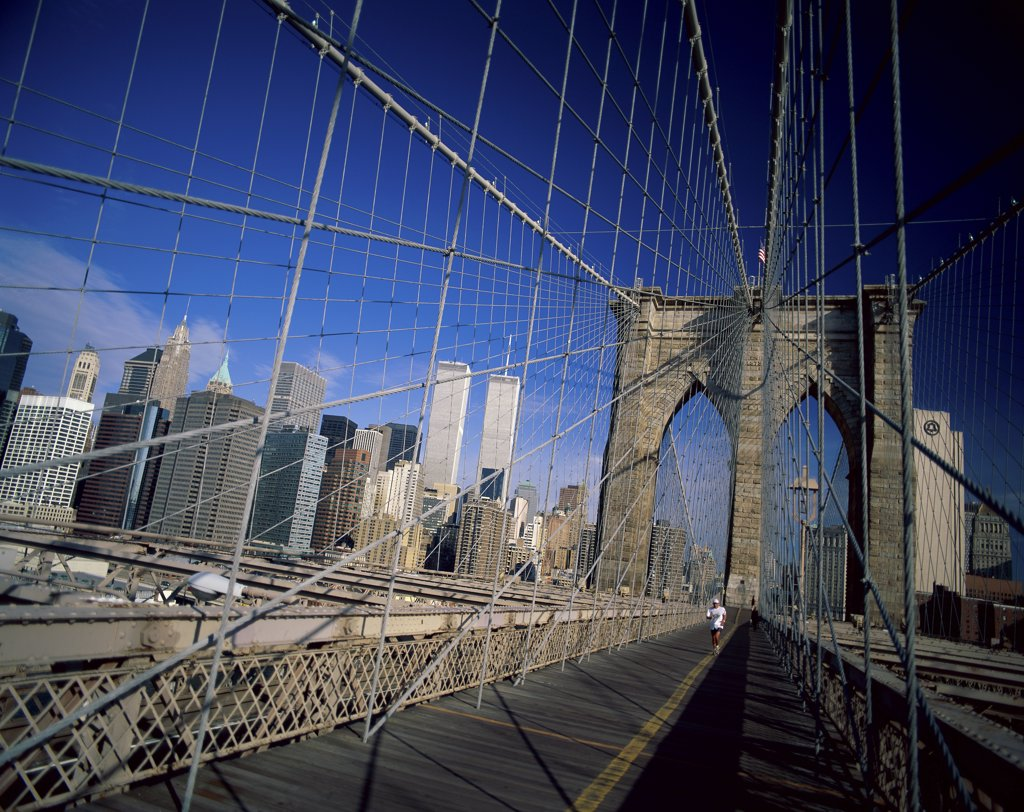 Person running on a bridge, Brooklyn Bridge, New York City, New York, USA : Stock Photo