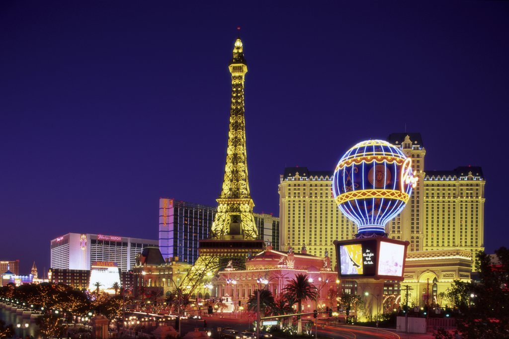 Stock Photo: 1288-951 Hotel lit up at dusk, Paris Las Vegas Hotel and Casino, Las Vegas, Nevada, USA