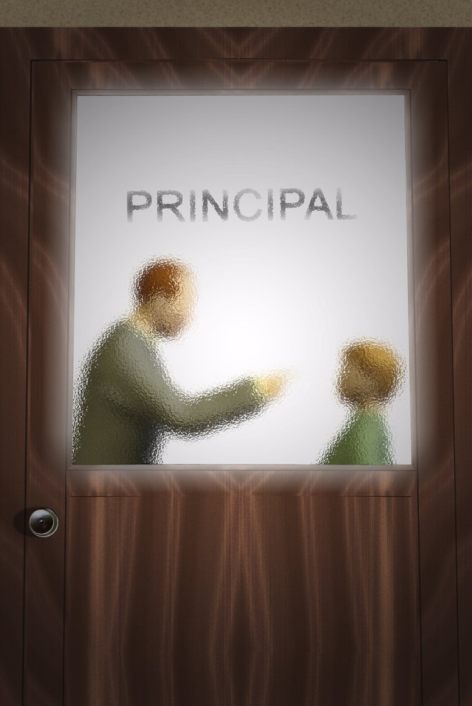 Principle speaking to a student in his office : Stock Photo