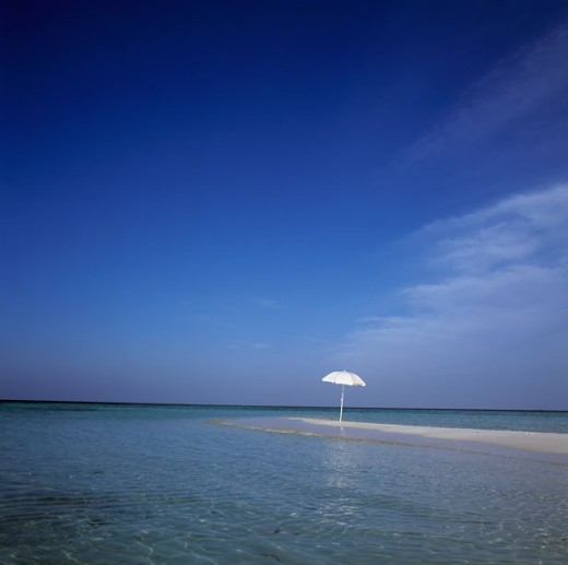 Stock Photo: 1290-133D Beach umbrella surrounded by water