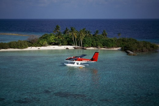 Aerial view of a seaplane near an island in the ocean, Maldives : Stock Photo