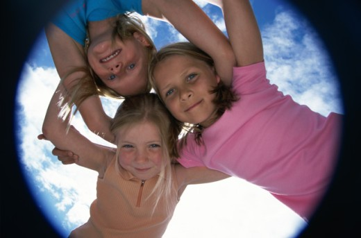 Stock Photo: 1290-265 Low angle view of three girls making a huddle