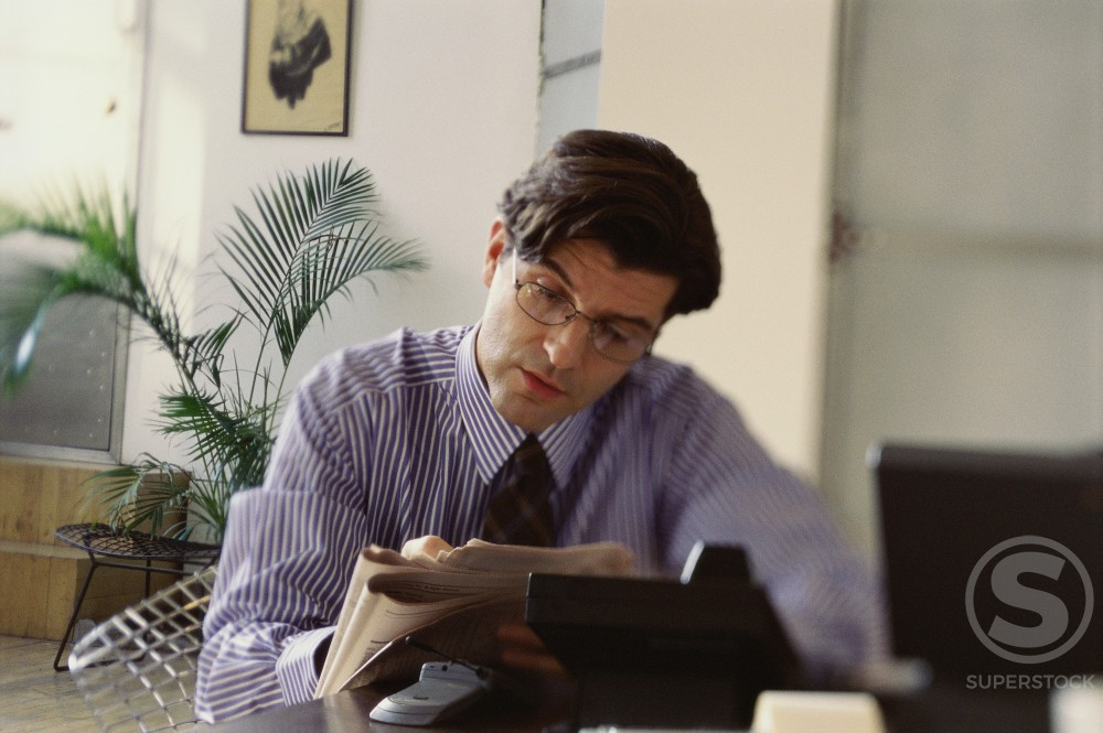 Stock Photo: 1295-226 Businessman reading a newspaper