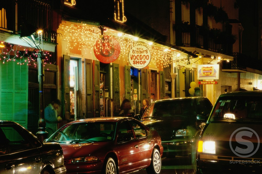 Store sign lit up at night, Bourbon Street, French Quarter, New Orleans, Louisiana, USA : Stock Photo