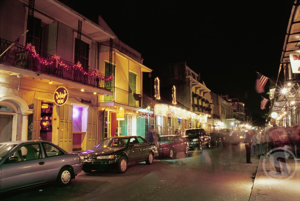 Cars parked in front of buildings, Bourbon Street, New Orleans, Louisiana, USA : Stock Photo