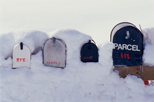 Close-up of four mailboxes in snow : Stock Photo