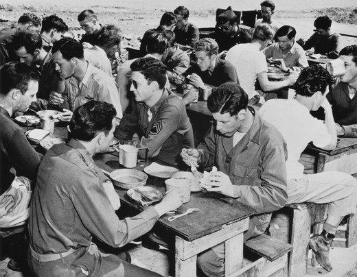 Group of army soldiers having meal, Foggia, Italy, 1940s : Stock Photo