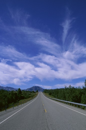 Road passing through the countryside, Glacier National Park, Montana, USA : Stock Photo