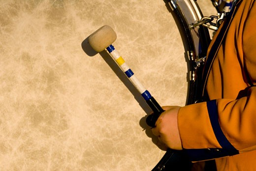 Stock Photo: 1311-1772 Close-up of a person carrying a drum and drumstick