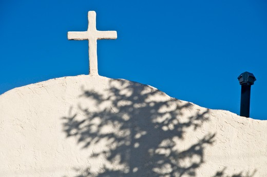 Cross on the top of a church, Our Lady of Guadalupe, Encino, New Mexico, USA : Stock Photo