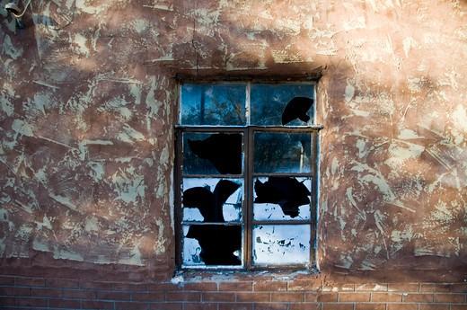 Broken window of an old house, Encino, New Mexico, USA : Stock Photo
