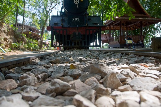 Stock Photo: 1311-2278 Thailand, Hellfire Canyon, old railroad truck with locomotive. Hellfire Canyon was the scene of the most brutal of all POW construction sites as prisoners dug through canyon walls with little more then small hand tools.