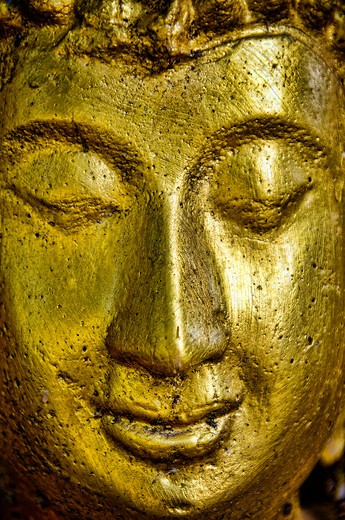 Stock Photo: 1311-2283 Close up of hold Buddha's face