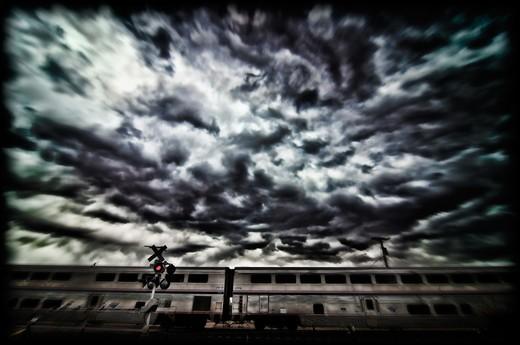 Amtrak's Superchief train moving under cloudy sky, Santo Domingo Pueblo, Santo Domingo, New Mexico, USA : Stock Photo