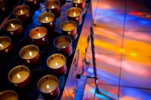 Stock Photo: 1311-2574 Votive candles burning in a cathedral, St. Francis Cathedral, Santa Fe, New Mexico, USA