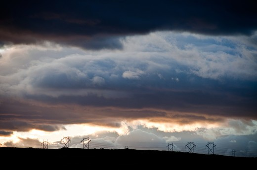 Storm clouds over electricity pylons, Sandia Mountains, New Mexico, USA : Stock Photo