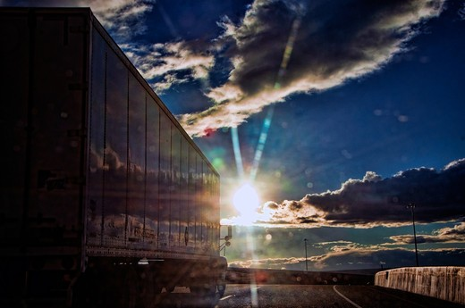 USA, New Mexico, Albuquerque, truck on highway in afternoon sunlight : Stock Photo