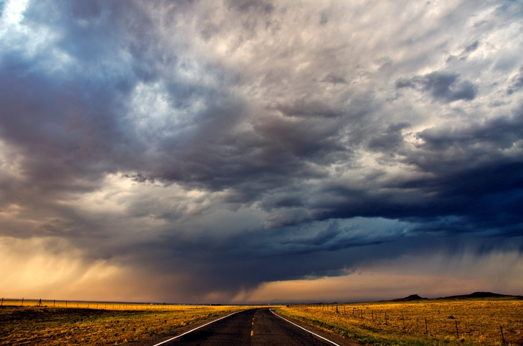 Stock Photo: 1311-2663 Highway under the cloudy sky at sunset, New Mexico, USA