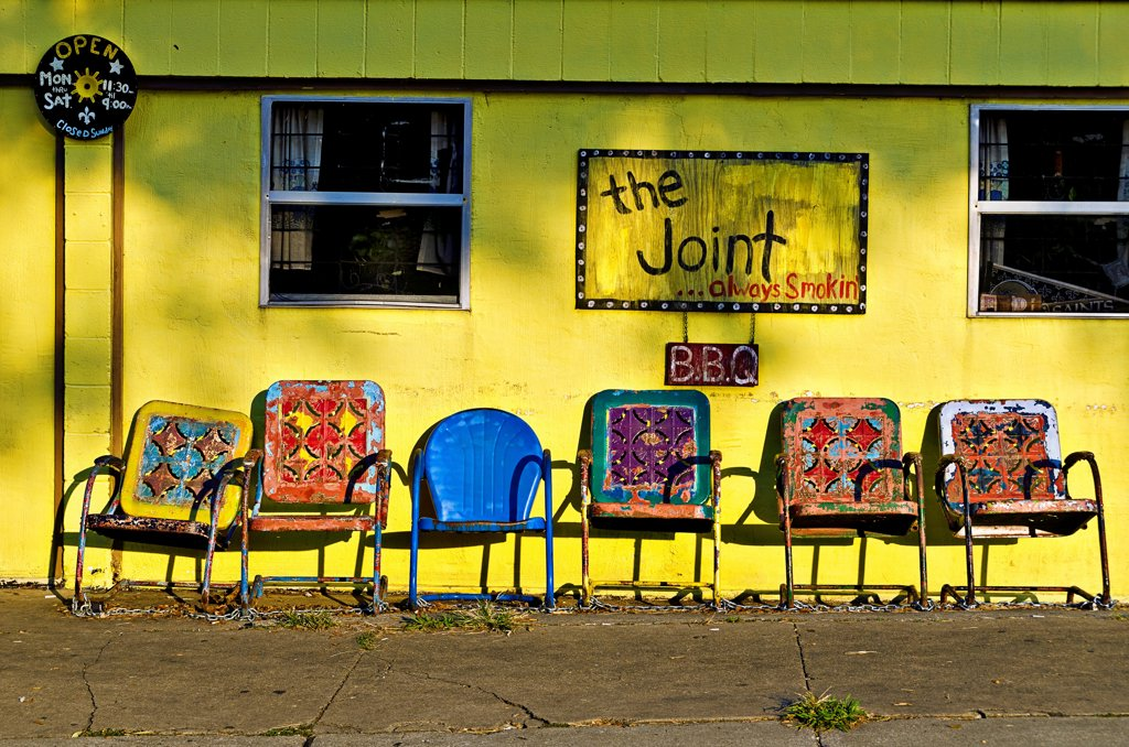 Stock Photo: 1311-2687 Colorful chairs at a bar-be-que restaurant, The Joint, Bywater, Ninth Ward, New Orleans, Louisiana, USA