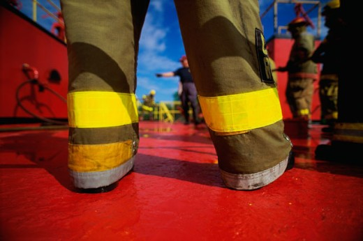 Stock Photo: 1311-918 Low angle view of a firefighter in training