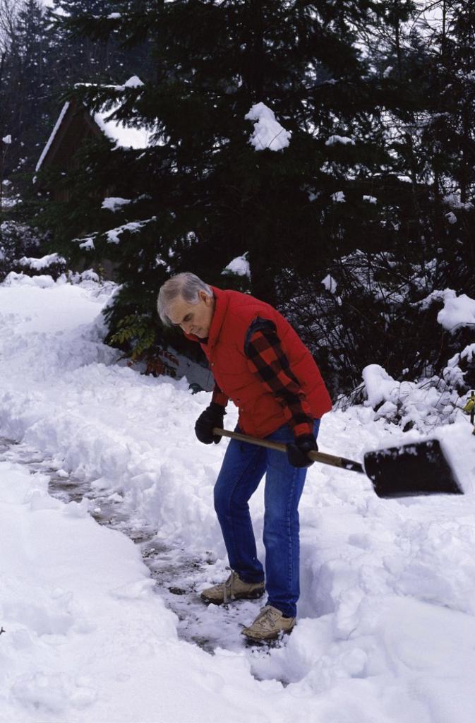 Stock Photo: 1315-106 Side profile of a senior man shoveling snow