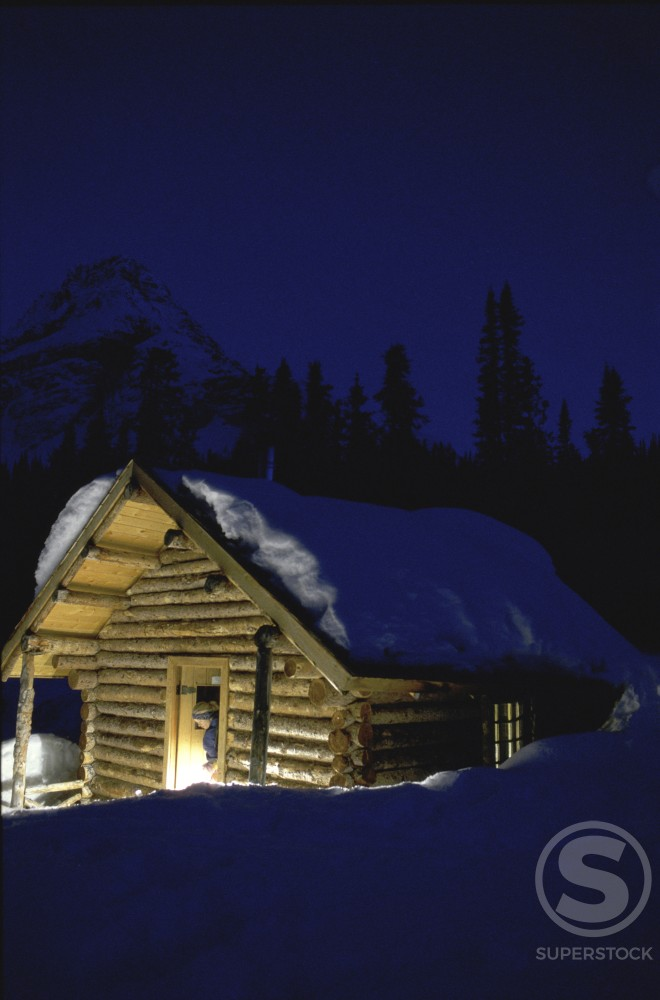Snow on the roof of a log cabin : Stock Photo