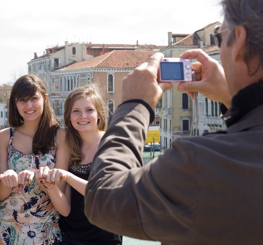 Stock Photo: 1315-1070 Mature man taking a photograph of his daughters, Grand Canal, Venice, Venice Province, Veneto, Italy