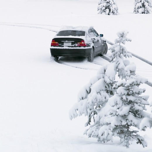 Stock Photo: 1315-1148 Car slips in deep snow while driving through parking lot, Canada