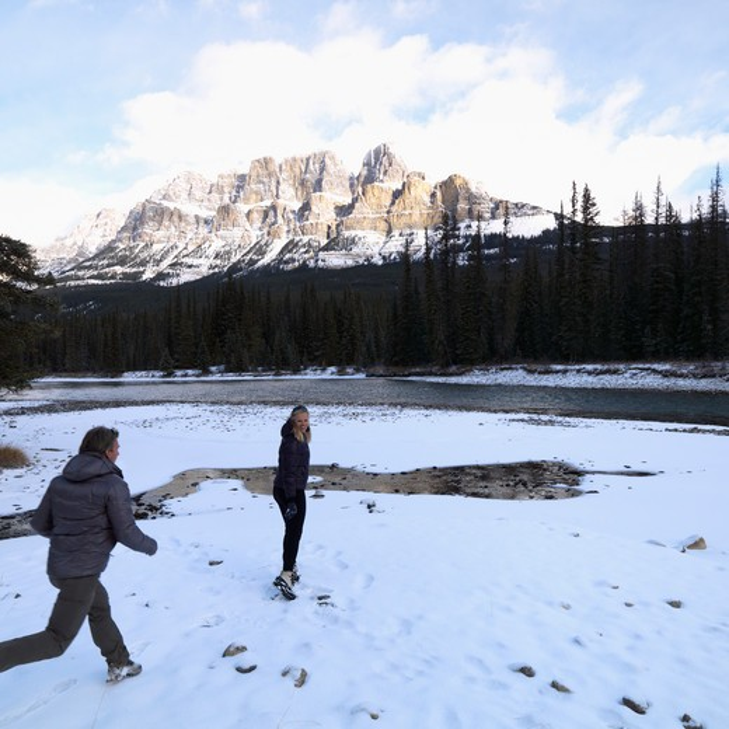Mature couple enjoying in snow, Castle Mountain, Alberta, Canada : Stock Photo
