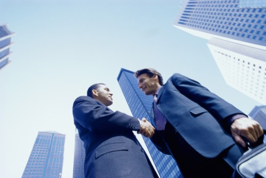 Stock Photo: 1315-197 Low angle view of two businessmen shaking hands