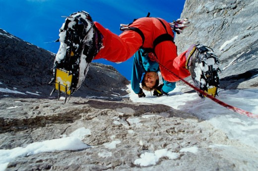 Stock Photo: 1315-200B Low angle view of mid adult man climbing a mountain, Banff, Alberta, Canada