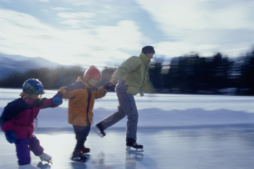 Stock Photo: 1315-202B Mother ice skating with her son and daughter, Jasper, Alberta, Canada
