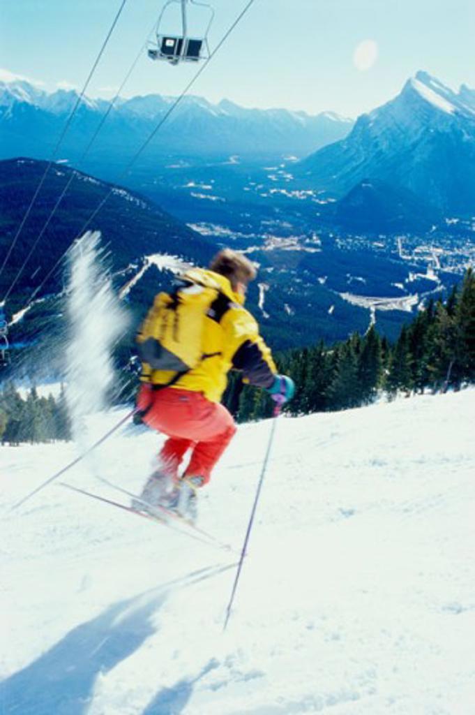Rear view of a man skiing, Banff National Park, Alberta, Canada : Stock Photo