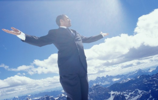 Low angle view of a businessman standing with his arm outstretched, Banff, Alberta, Canada : Stock Photo