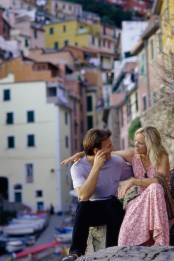 Mid adult couple looking at each other, Riomaggiore, Italy : Stock Photo