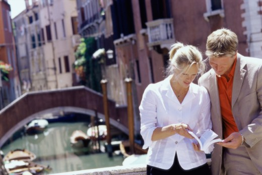 Stock Photo: 1315-548 Young couple reading a book, Venice, Italy