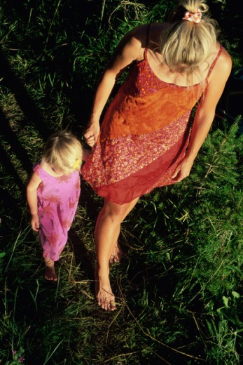Stock Photo: 1315-655 High angle view of a mother and daughter walking on the grass