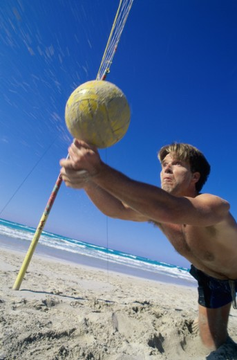 Young man playing beach volleyball : Stock Photo