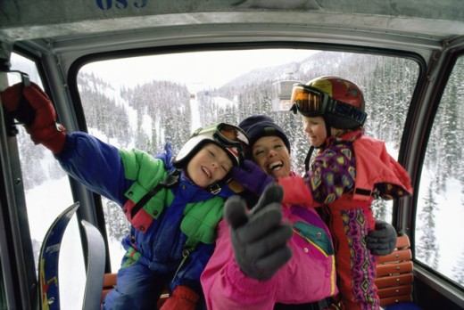 Stock Photo: 1315-730 Portrait of a mother with her son and daughter in a cable car, Alberta, Canada