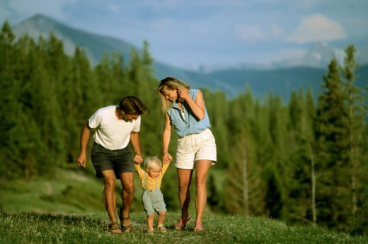Parents walking with their son : Stock Photo
