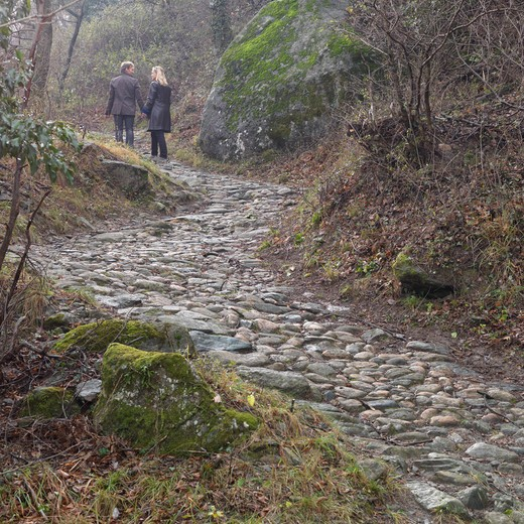Stock Photo: 1315R-10239 Italy, Piedmont, Sacra di San Michele, Couple walking up cobblestone path
