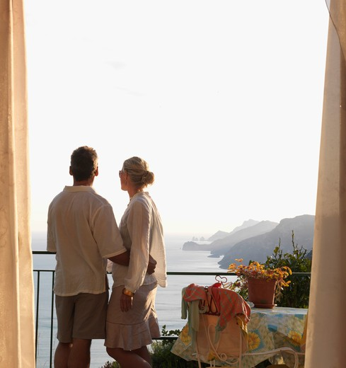 Italy, Amalfi, Couple look out from hotel suite over positano : Stock Photo